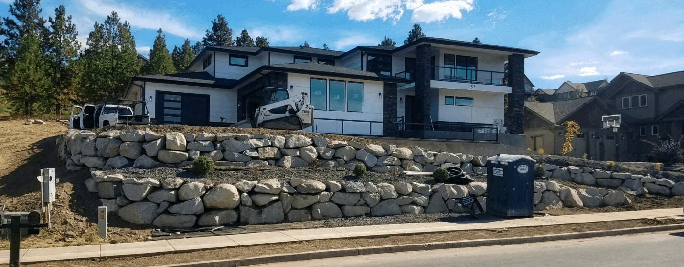 Boulder Wall around House
